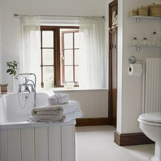 beautiful trim - keeping it dark with stark white walls, curtains, cabs, etc.