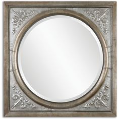 Ornate, embossed metal frame with an antiqued, burnished silver finish. Mirror is beveled.