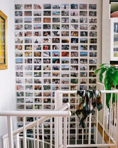 """To create this photo wall, """"we made a grid with string,"""" Marci explains. """"Once the grid was up, it was easy to mount the photos on the wall."""""""