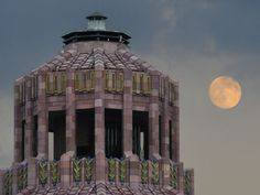 A harvest moon rises beside the octagonal roof dome of the Asheville City Hall. Harvest moons occur around the autumn equinox, when the sun appears to cross the celestial equator, from north to south, marking the beginning of autumn in the Northern hemisphere | Photo by Bill Sanders via Asheville Citizen-Times