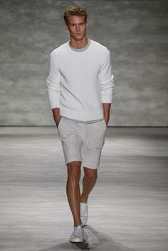 This combination of a white crew-neck jumper and grey shorts is perfect for off-duty occasions. A pair of white low top sneakers will seamlessly integrate within a variety of outfits. Shop this look on Lookastic: https://lookastic.com/men/looks/white-crew-neck-sweater-grey-shorts-white-low-top-sneakers/18207 — White Crew-neck Sweater — Grey Shorts — White Low Top Sneakers