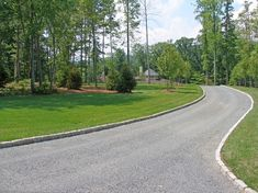 Tar and chip driveway with Belgian block curbing leads to a cobblestone courtyard. Driveway Edging, Gravel Driveway, Driveway Entrance, Driveway Landscaping, Driveway Ideas, Walkway, Tarmac Driveways, Long Driveways, Tar And Chip Driveway