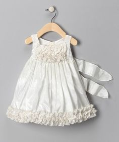 Take a look at this Ivory Ruffle Dress - Infant by Chic Baby on #zulily today!