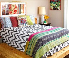 Use a menagerie of patterns in your bedroom without the circus effect. Vary the scale of patterns and include a pattern that reads as neutral. Although the bedspread is patterned, its black and white color scheme serves as a visual break. It also has the largest pattern, so it dominates, and the smaller patterns on the pillows balance it out. Look for color commonalities between the patterns you use and you'll have a look that's eclectic, yet collected.