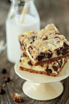 Creamy cheesecake is topped with chocolate chip cookie dough to create an amazingly delicious bar dessert.