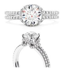 Hearts On Fire: Optima, Engagement Ring.  Love the setting!  The band of diamonds that wrap around the main diamond is stunning!
