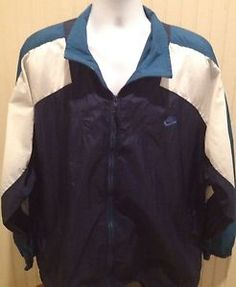 "$54.95 Up for purchase is a RARE Vintage Nike Nylon Jacket.  Length: 30.5""  Width: 27""  Sleeves: 28""  Size: XL  Color: Dark Blue, Baby Blue, White  Made in: Malaysia   Made By: Nike   Material: Body- 100% Nylon/Liner- 100% Polyester   Condition: Great Condition.Draw Strings show minor wear. #VintageNike #VintageJordan #AirJordan #OldSchool #Ebay"
