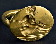 The Valley of the Thracian Kings: Gold signet ring with a carved relief of a resting athlete. Burial mound Svetitsa to the village. Kran, Kazanlak. The end of the V c. BC.