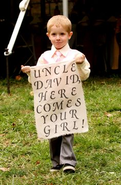 My adorable nephew Levi;) I Made this sign for him to carry.  Taken by Joma Studios Photography