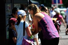 Victoria Azarenka (BLR)[1] signs autographs on the grounds on Day 3 of the 2012 US Open. - Andrew Ong/USTA