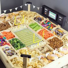 How do you serve snacks during football parties? My amazing Husband built this snack stadium from wood and it has LED lights, a scoreboard to hold a tablet and lots of room for food! Full details #ontheblognow. #gamedayglory #snackstadium #ad #footballparty #football #diy #partyplatter #cbias