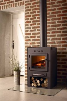 Contemporary Wood Burning Stove (especially the wood underneath)