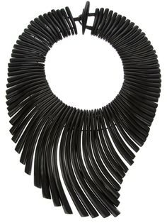 Dramatic black neck piece