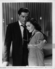 Ray Milland embrace woman in a scene from the film 'The Big Clock', 1948.