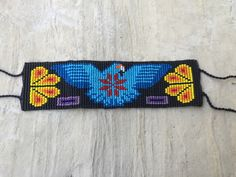A personal favorite from my Etsy shop https://www.etsy.com/listing/458161014/authentic-huichol-beaded-bracelet-native