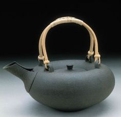 """John Neely, """"Teapot,"""" reduction cooled. Neely maintained reduction conditions in his kiln during the cooling period. In this way he was able to produce the black body color we see in this piece. A glaze would be redundant here."""