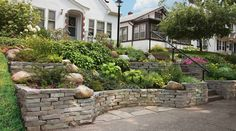 How to Build a Stacked Stone Retaining Wall No matter how small your yard, mowing a steep slope can be a dreadful task.
