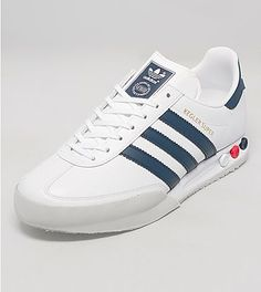 adidas Kegler Super - adidas Originals present this size? exclusive Kegler Super. First released in the 1980s as a training shoe and is possibly the most recognisable of its design. This size? exclusive silhouette is presented in a white leather upper, with navy blue three stripe branding to the side walls. This shoe features a grey toe bumper overlay and sits upon a white midsole which features the famous interchangeable peg cushioning system.