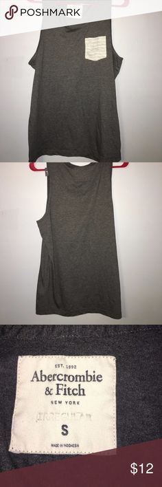 Abercrombie and Fitch Small Gray Tank Top Abercrombie and Fitch tank top. Dark grey color with a pocket on the front that is gray and white striped. Ask me anything! Abercrombie & Fitch Tops Tank Tops