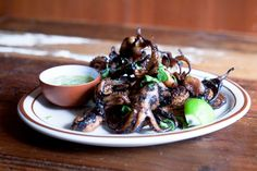 grilled baby octopus with lime, garlic, and chili dipping sauce at uncle boons