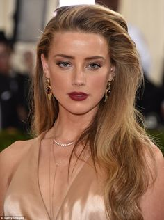 Natural beauty: Amber had her long blonde hair down in soft curls around her shoulders...