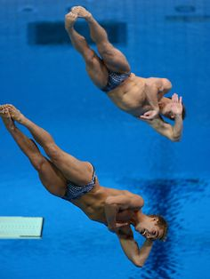 USA's Kristian Ipsen, bottom, from Walnut Creek, dives with Troy Dumais, for their sixth of six dives for the Men's Synchronized 3m Springboard at the Aquatics Centre for the London 2012 Olympics in London, England on Wednesday, August 1, 2012.