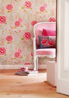 Love the vintage-like wallpaper and the pink French chair!