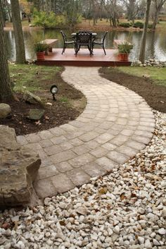 Paver walkway to the deck on the water! Landscape ideas