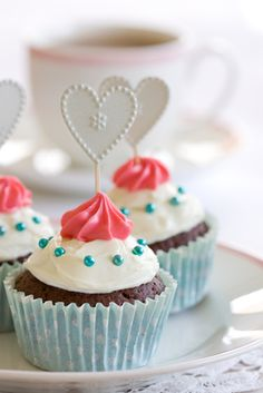 Delightful cupcake toppers and frosting. #food #cupcakes #hearts #wedding