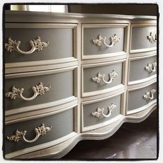 I like the way this was done with the contrasting - darker area within the drawer trim and the handles to match the fames.