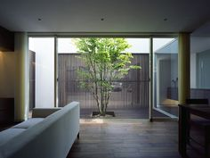 wide sliding glass door that opens into an interior courtyard
