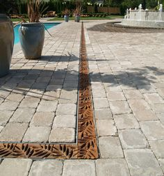 PAVER COLOR pool landscaping Iron Age Designs raw iron drainage grate with mitered corners in their Locust pattern Landscape Architecture, Landscape Design, Garden Design, Spa Design, Outdoor Rooms, Outdoor Gardens, Outdoor Living, Drainage Grates, Tree Grate