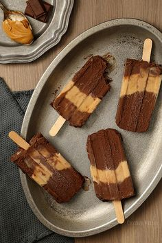 Cool down when the weather gets hot with these Chocolate Peanut Butter Fudgesicles, which taste like you're eating a peanut butter cup on a stick! Very fudgy, very decadent, and a little messy.