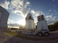 SpaceX ground crews transfer the Dragon pad abort vehicle. Credit: SpaceX