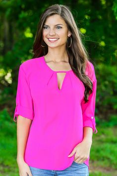 The brighter, the better! Must have hot pink blouse with keyhole front and button-tab sleeves. We are obsessed!