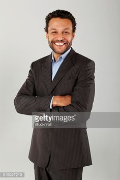 Stock-Foto : Confident business executive with his arms crossed