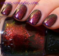Scrangie: Nfu Oh 51 over SpaRitual Blue Moon.      I duped this with Orly Royal Velvet, Essie Shine of the Times, and a coat of Sinful Colors I Love You.