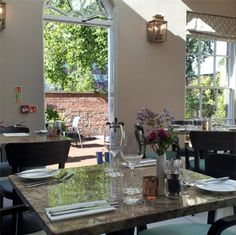 'eleven' restaurant ready for breakfast on a sunny day at Houndgate Townhouse, Darlington, England.