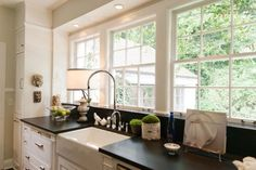Bathed in natural light, the galley kitchen is efficient and practical. Once bright pink, Gavin and Lorie selected a more subdued tone. Cottage Kitchens, Home Kitchens, New Kitchen, Kitchen Decor, 1950s Kitchen, Kitchen Sink, Kitchen Ideas, Home Renovation, Home Remodeling