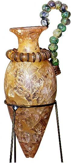 One of the finest of the stone vessels from the Temple Repositories is the unique rhyton of rock crystal -ca 1500 - 1450 BC - shown from the Palace of Zakros.    The body of the vase made from an unusually large piece of rock crystal is joined to the neck by a gilt ring. Crystal beads threaded onto a bronze wire form the handle.