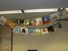 I am in love with this banner. She took old paper book covers and laminated them and glued them to ribbon to hang over her library.