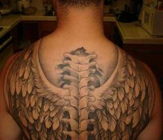 awesome winged and vertebral column tat