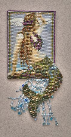 Mermaid beaded amulet bag(front side). Amulet bag made with Delica beads in peyote and brick stitch. Work in progress.