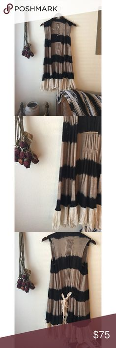 Free People Dip Dye Gauzy Fringe Vest Black and Tan dip dye together beautifully for a classically bohemian touch. Gauzy trim with a romantic tie back or front tie for added styling.    Mandy Mae's Closet  For the girl on the go ✌🏽️  By: Free People  Size: XS--- can fit most sizes in my opinion, see measurements below.  Dimensions: B: 20 L: 35 VGUC,  Cotton, Rayon  Blend.   Please feel free to use the offer button, and I will do what I can to help a girl out! 👌🏽 Jackets & Coats Vests