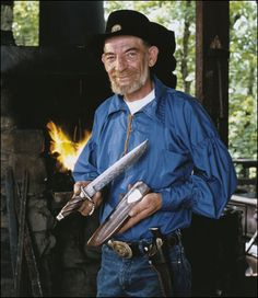 Knife Maker Handcrafted Knives.  THIS PICTURE WAS TAKEN AT THE AMUSEMENT PARK SILVER DOLLAR CITY IN BEAUTIFUL BRANSON MISSOURI:-)