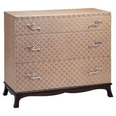 Textured three-drawer chest with scrolling metal pulls.Product: Chest    Construction Material: Birch wood and vinyl    Color: Gold   Features:   Three drawers    Will enhance any décor     Decorative hardware   Dimensions: 34 H x 38 W x 17 D