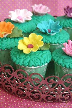 Cupcakes with turquoise fondant and sugar flowers