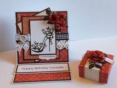 (Ref:B145) 15cm x 15cm easel card. Backing papers Nitwit download 'Crab Apple Lane'. Dies used, Tattered Lace shoe die, La La Land 'Berry Flourish', Dienamics 'Rolled Daisy', Marianne 'Rolled Roses', Spellbinders 'Border Die'. Small box made with Spellbinders 'Grand Die', rose made using Sue Wilson 'Flower Die'.