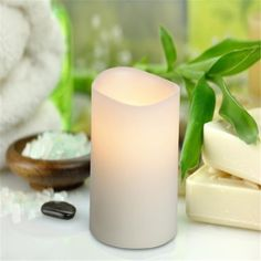 LED Lighted Flickering Votive Style Flameless Candles Battery Operated Ivory Colored Wax Amber Yellow Flame Pillar Candles | Beautiful pillar candles that provide a warm flickering amber light with its single LED bulb. These candles have a wonderful vanilla scent.
