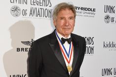 Actor Harrison Ford suffered a bloody head wound when a World War II-era training plane he was flying crashed onto a California golf course, multiple news outlets reported Thursday evening.